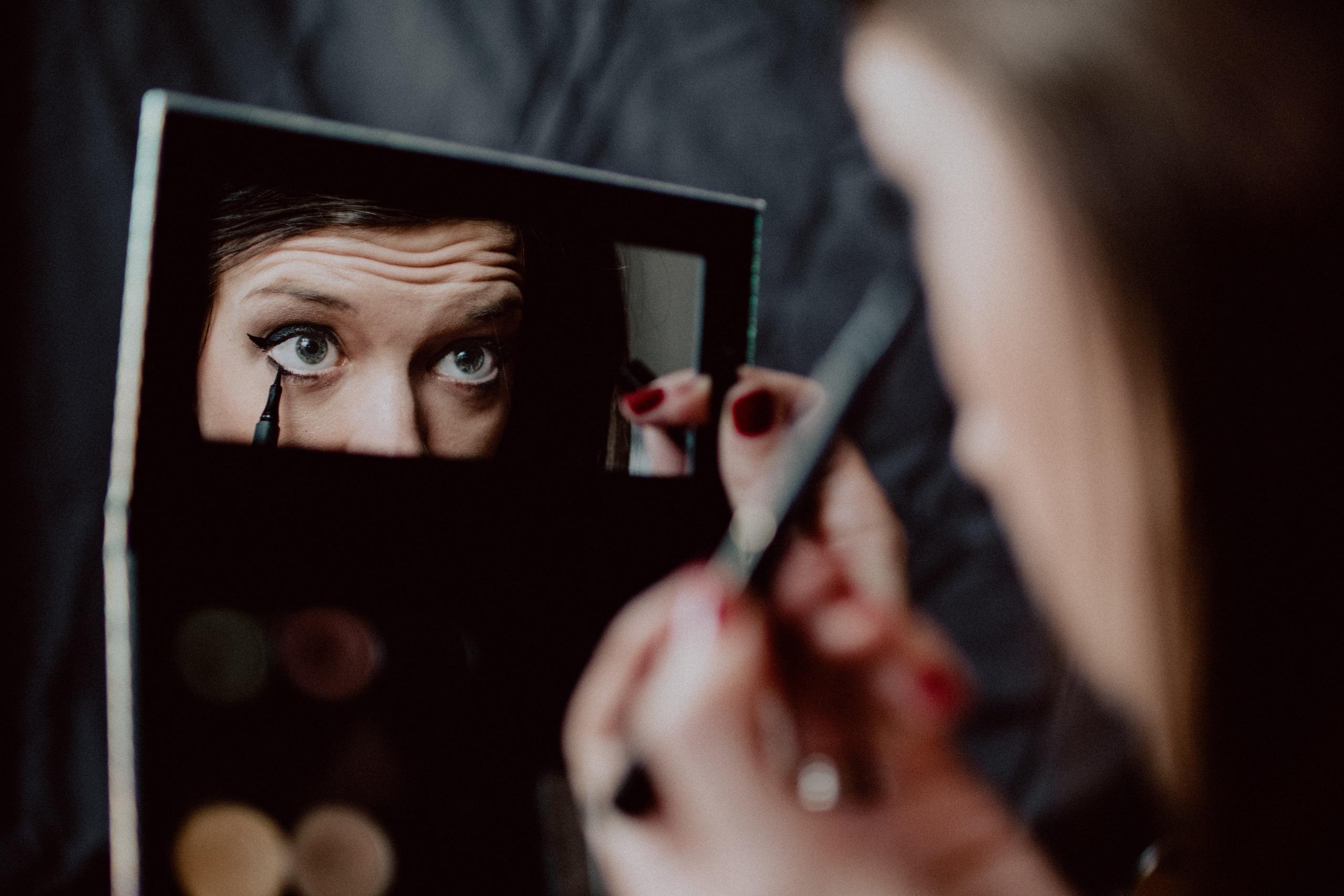 a girl doing makeup